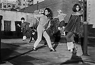 New York City, NY, 1966-1967. <br /> A community of transgenders, living around 66th Street and Broadway where they use to work at night. During the day instead they design clothes, play with dolls, and organize little fashion shows on the rooftops.