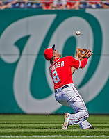 14 April 2013: Washington Nationals second baseman Danny Espinosa makes an over-the-shoulder catch during a game against the Atlanta Braves at Nationals Park in Washington, DC. The Braves shut out the Nationals 9-0 to sweep their 3-game series. Mandatory Credit: Ed Wolfstein Photo *** RAW (NEF) Image File Available ***