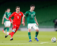 27th March 2021; Aviva Stadium, Dublin, Leinster, Ireland; 2022 World Cup Qualifier, Ireland versus Luxembourg; Josh Cullen (Republic of Ireland) plats the bal away as Danel Sinani (Luxembourg) closes in