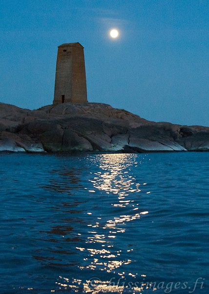 Segelskär Day Beacon with full moon's reflection in the outer archipelago near Tammisaari, Finland.