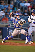Midland RockHounds catcher Beau Taylor (24) throws down to second in front of Jared Simon (6) during a game against the Tulsa Drillers on May 31, 2014 at ONEOK Field in Tulsa, Oklahoma.  Tulsa defeated Midland 5-3.  (Mike Janes/Four Seam Images)