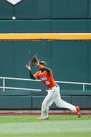 Miami Hurricanes outfielder Jacob Hayward (24) makes a running catch against the UC Santa Barbara Gauchos in Game 5 of the NCAA College World Series on June 20, 2016 at TD Ameritrade Park in Omaha, Nebraska. UC Santa Barbara defeated Miami  5-3. (Andrew Woolley/Four Seam Images)