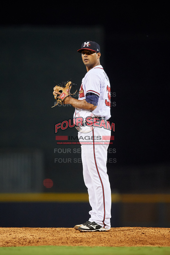 Mississippi Braves relief pitcher Elian Leyva (36) gets ready to deliver a pitch during a game against the Mobile BayBears on May 7, 2018 at Trustmark park in Pearl, Mississippi.  Mobile defeated Mississippi 5-0.  (Mike Janes/Four Seam Images)