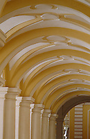 A colonnade supports the vaulted ceiling of this corridor