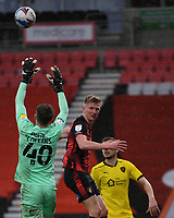 13th March 2021; Vitality Stadium, Bournemouth, Dorset, England; English Football League Championship Football, Bournemouth Athletic versus Barnsley; Bradley Collins of Barnsley goes up to catch the shot under pressure from Sam Surridge of Bournemouth