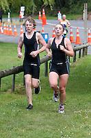 Physical Fitness.  Triathlon Runners, Blue Lake, Rotorua, New Zealand.