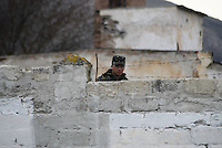 Ukrainian soldier behind the walls of occupied military base in Perevalnoe