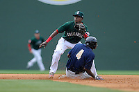 Infielder Jose Vinicio (36) of the Greenville Drive waits for the throw from home as Claudio Custodio (4) of the Charleston RiverDogs steals second base in a game on Sunday, May 19, 2013, at Fluor Field at the West End in Greenville, South Carolina.  Vinicio is the No. 17 prospect for the Boston Red Sox, according to Baseball America. (Tom Priddy/Four Seam Images)  .