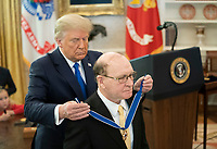 President Trump Presents the Medal of Freedom to Dan Gable<br /> <br /> President Donald J. Trump presents the Medal of Freedom to Dan Gable Monday, Dec. 7, 2020, in the Oval Office of the White House. (Official White House Photo by Tia Dufour)