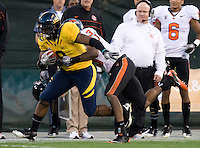 C.J. Anderson of California runs the ball away from Oregon State defender during the game at AT&T Park in San Francisco, California on November 12th, 2011.   California defeated Oregon State, 23-6.