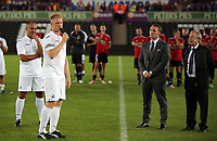 Alan Tate speaks to supporters surrounded by Roberto Martinez, Brendan Rodgers and Brian Flynn during the Alan Tate Testimonial Match, Swansea City Legends v Manchester United Legends at the Liberty Stadium, Swansea, Wales, UK