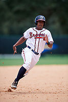 GCL Braves third baseman Braulio Vasquez (20) runs the bases during the second game of a doubleheader against the GCL Yankees West on July 30, 2018 at Champion Stadium in Kissimmee, Florida.  GCL Braves defeated GCL Yankees West 5-4.  (Mike Janes/Four Seam Images)