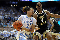 CHAPEL HILL, NC - MARCH 03: Cole Anthony #2 of the University of North Carolina drives past Jahcobi Neath #4 of Wake Forest University during a game between Wake Forest and North Carolina at Dean E. Smith Center on March 03, 2020 in Chapel Hill, North Carolina.