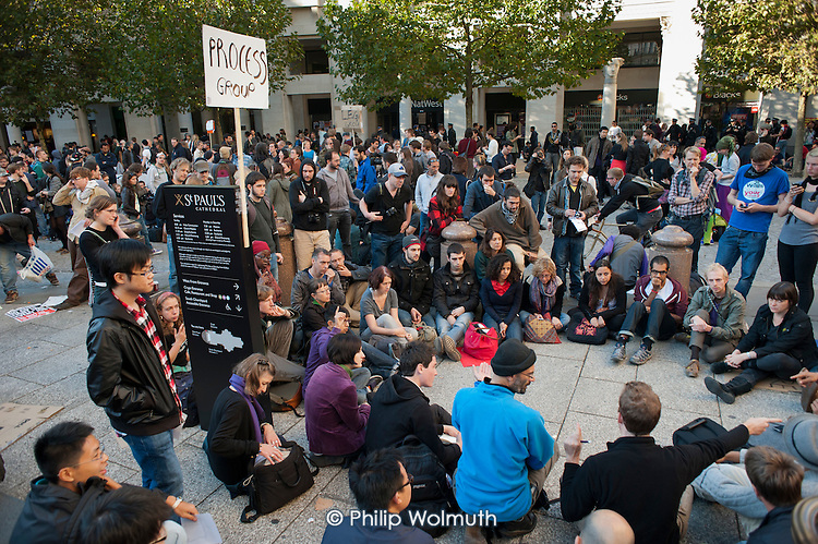 Organising group meeting. Occupy the London Stock Exchange. Protesters gather at St.Pauls Cathedral on a global day of action against corporate greed.
