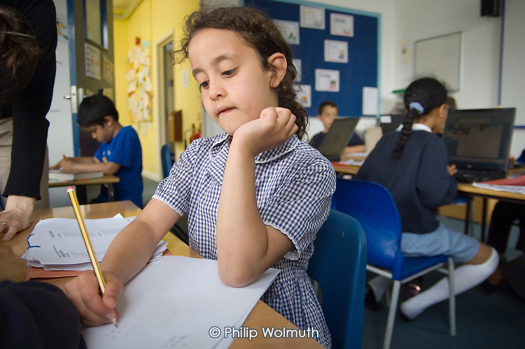 After-school homework club for Year 3 and 4 pupils at St.Peter's C of E Primary School, Paddington, London.