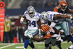 Dallas Cowboys running back Phillip Tanner (34), Dallas Cowboys tackle Jermey Parnell (78) and Cincinnati Bengals defensive end Wallace Gilberry (95) in action during the pre- season game between the Cincinnati Bengals and the Dallas Cowboys at the AT & T stadium in Arlington, Texas. Dallas defeats Cincinnati 24 to 18.