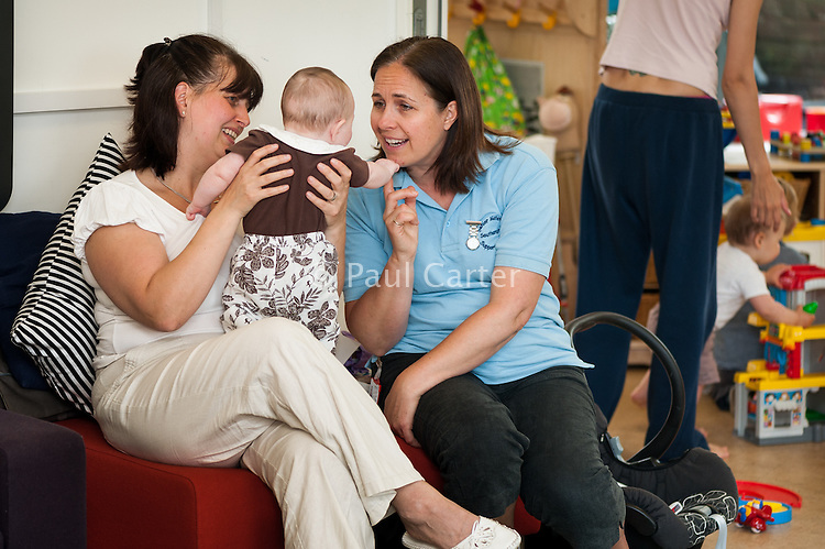 A midwifery support worker talks to a mother at a breastfeeding support drop-in centre.<br /> <br /> 01/06/2011<br /> Hampshire, England, UK