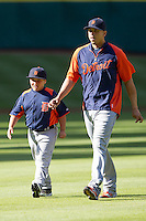 Detroit Tigers designated hitter Victor Martinez (41) with his son before the MLB baseball game against the Houston Astros on May 3, 2013 at Minute Maid Park in Houston, Texas. Detroit defeated Houston 4-3. (Andrew Woolley/Four Seam Images).