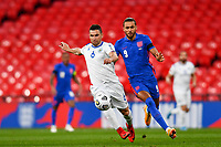 25th March 2021; Wembley Stadium, London, England;  Rossi Dante CarlSan Marino and Dominic Calvert-Lewin England challenge for the ball during the World Cup 2022 Qualification match between England and San Marino at Wembley Stadium in London, England.