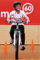 Tatanya Whittaker rides her new bike at the Move 60 event run by Cocacola at Pioneer Stadium Gymnasium, Christchurch, New Zealand on Saturday, 12 April 2014. Photo: Joseph Johnson.