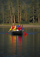 Retired couple canoeing on Lake Dillon, CO. (MR 451, 452). Colorado.