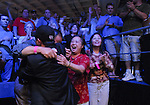 Jerry Yang is mobbed by family after eliminating an opponent.