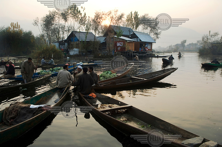 Floating market workers on canoes on Dal Lake.