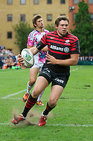 20120823 Copyright onEdition 2012©.Free for editorial use image, please credit: onEdition..Alex Goode of Saracens dances his way to the tryline at The Honourable Artillery Company, London in the pre-season friendly between Saracens and Stade Francais Paris...For press contacts contact: Sam Feasey at brandRapport on M: +44 (0)7717 757114 E: SFeasey@brand-rapport.com..If you require a higher resolution image or you have any other onEdition photographic enquiries, please contact onEdition on 0845 900 2 900 or email info@onEdition.com.This image is copyright the onEdition 2012©..This image has been supplied by onEdition and must be credited onEdition. The author is asserting his full Moral rights in relation to the publication of this image. Rights for onward transmission of any image or file is not granted or implied. Changing or deleting Copyright information is illegal as specified in the Copyright, Design and Patents Act 1988. If you are in any way unsure of your right to publish this image please contact onEdition on 0845 900 2 900 or email info@onEdition.com