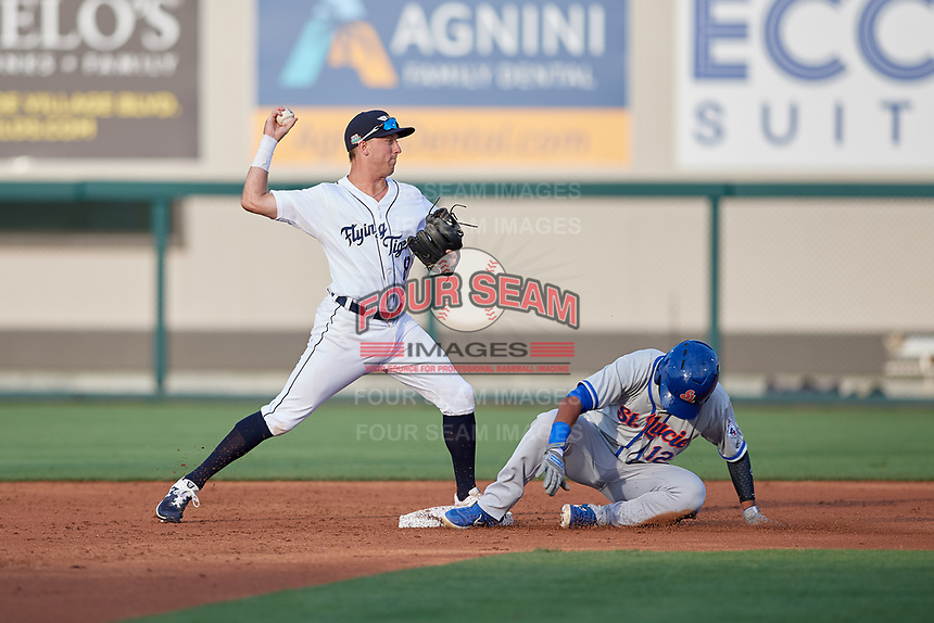 Lakeland Flying Tigers second baseman Kody Clemens (8) turns a double play as Luis Carpio (12) slides into the bag during a Florida State League game against the St. Lucie Mets on April 24, 2019 at Publix Field at Joker Marchant Stadium in Lakeland, Florida.  Lakeland defeated St. Lucie 10-4.  (Mike Janes/Four Seam Images)
