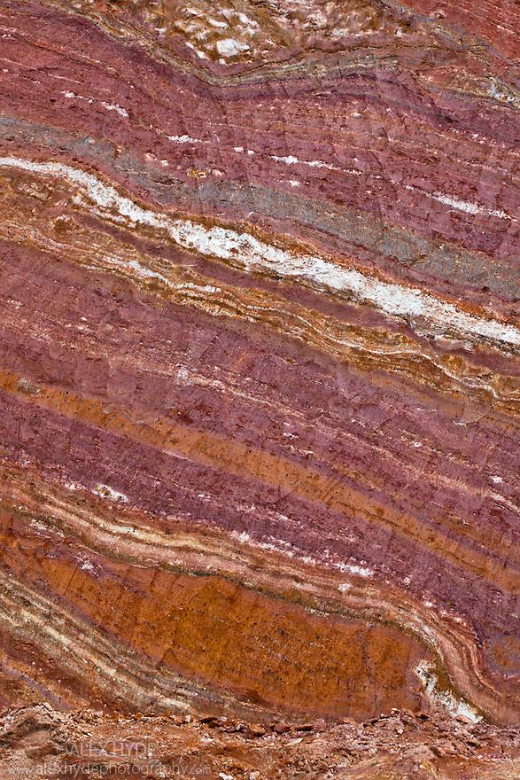 Clay deposits visible as distinct layers, exposed after roadside excavation, Andasibe-Mantadia National Park, Madagascar.