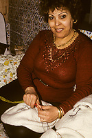 """Tunisian Hat, Chechia.  Woman Sewing a """"Nishan"""", the Manufacturer's Trademark, into Woolen Hats before Boiling and Dyeing."""