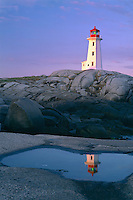 Granite headland<br />   and Peggy's Point Lighthouse at sunrise<br /> Peggy's Cove Preservation Area<br /> Nova Scotia,  Maritime Provinces,  Canada