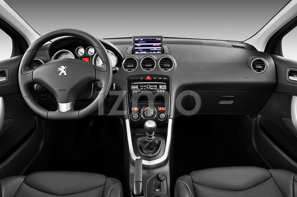 Straight dashboard view of a 2011 Peugeot 308 5 Door Hatchback .