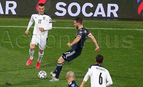 12th November 2020; Belgrade, Serbia; European International Football Playfoff Final, Serbia versus Scotland;  Filip KosticL Serbia closes in on Scott O'DonnellC Scotland