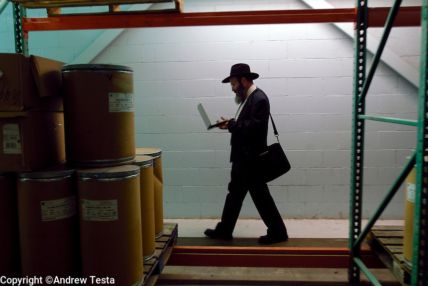 .Rabbi Avrohom Stone, a Masgiach employed by the Orthodox Union checks vats, containers and piping work at Technical Oil Products to make sure that nothing can enter the processes to contaminate whatever is being produced at the time. The company produces Emulsifiers, oils and also deals with various Fish oils. Rabbi Stone keeps an inventory of every container plus it?s contents. He also keeps an inventory of every ingredient and it?s origin. He does this for all 72 of the businesses that he deals with. He keeps all the information on his laptop..©Andrew Testa