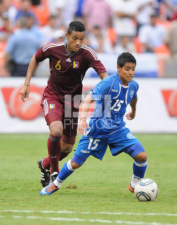 El Salvador midfielder Edwin Sanchez (15) shields the ball against Venezuela midfielder Juan Guerra (6). El Salvador National Team defeated Venezuela 3-2 in an international friendly at RFK Stadium, Sunday August 7, 2011.