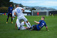 Olympic's Justin Gulley (5) and Jack Henry-Sinclair go in studs-up on Jake Williams, to earn Henry-Sinclair a straight red card, during the Central League football match between Miramar Rangers and Wellington Olympic AFC at David Farrington Park in Wellington, New Zealand on Saturday, 29 May 2021. Photo: Dave Lintott / lintottphoto.co.nz