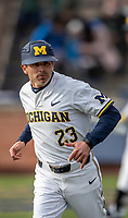 Michigan Wolverines assistant coach Nick Schnabel (23) during the NCAA baseball game against the Michigan State Spartans on May 7, 2019 at Ray Fisher Stadium in Ann Arbor, Michigan. Michigan defeated Michigan State 7-0. (Andrew Woolley/Four Seam Images)