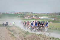peloton racing over the newly added gravel roads around Ploegsteert, called 'Plugstreets'<br /> <br /> 79th Gent-Wevelgem 2017 (1.UWT)<br /> 1day race: Deinze › Wevelgem - BEL (249km)