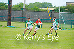 St Michaels Foilmore's Sean Scanlon tries to find a way around the Ballyduff defence of Paul O'Carroll and Kyle O'Connor in the County Senior football league.