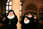 Nuns at St Mary at the Cross Edgware Abbey. Sisters in the Refectory (the monastic dining room)  Edgware, Middlesex UK 1980s 1989.