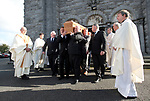 The coffin is carried from the cathedral to a crypt following the funeral mass of Bishop Eamonn Casey in Galway. Photograph by John Kelly.