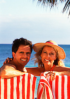 Smiling couple in beach chairs
