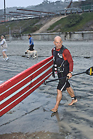 Tom Jones pushes his paddleboard into the water at La Jolla Shores, California near Scripps Institution of Oceanography early on Saturday, November 3 2007.  Tom is set to become the first person to paddle the length of the California coast when his journey ends on Sunday at the Mexican border.  He hopes that his achievement will draw attention to the large amount plastic pollution in the oceans.