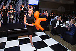 © Joel Goodman - 07973 332324 . 05/03/2015 .  Midland Hotel , Manchester , UK . Woman collects orange dog prize in a tombola in aid of Childline . The Manchester Legal Awards 2015 . Photo credit : Joel Goodman