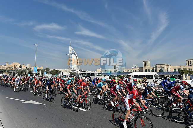 The peloton pass by the Burj al Arab during Stage 1 The Nakheel Stage of the Dubai Tour 2018 the Dubai Tour's 5th edition, running 167km from Skydive Dubai to Palm Jumeirah, Dubai, United Arab Emirates. 6th February 2018.<br /> Picture: LaPresse/Fabio Ferrari   Cyclefile<br /> <br /> <br /> All photos usage must carry mandatory copyright credit (© Cyclefile   LaPresse/Fabio Ferrari)