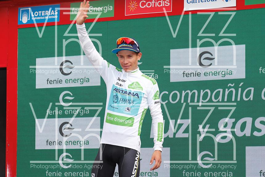 ESPAÑA, 29-08-2019: Miguel Angel Lopez (C=L - ASTANA) celebra con el maillot blanco mejor corredor joven después de la etapa 6, hoy, 29 de agosto de 2019, que se corrió entre Mora de Rubielos y Ares del Maestrat con una distancia de 198,9 km como parte de La Vuelta a España 2019 que se disputa entre el 24/08 y el 15/09/2019 en territorio Español. / Miguel Angel Lopez (COL - ASTANA) celebrates with the white best young rider jersey after stage 6 today, August 29, 2019, from Mora de Rubielos to Ares del Maestrat with a distance of 198,9 km as part of Tour of Spain 2019 which takes place between 08/24 and 09/15/2019 in Spain.  Photo: VizzorImage / Luis Angel Gomez / ASO<br /> VizzorImage PROVIDES THE ACCESS TO THIS PHOTOGRAPH ONLY AS A PRESS AND EDITORIAL SERVICE AND NOT IS THE OWNER OF COPYRIGHT; ANOTHER USE HAVE ADDITIONAL PERMITS AND IS  REPONSABILITY OF THE END USER