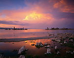 Mono Basin Scenic Area, CA:  Evening sky and colorful cumulus cloud reflects in a shallow pool at the shoreline near Mono Lakes's South Tufa Area