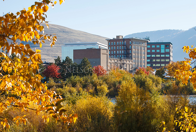 Fall colors along the Clark Fork River and buildings of downtown Missoula, Montana