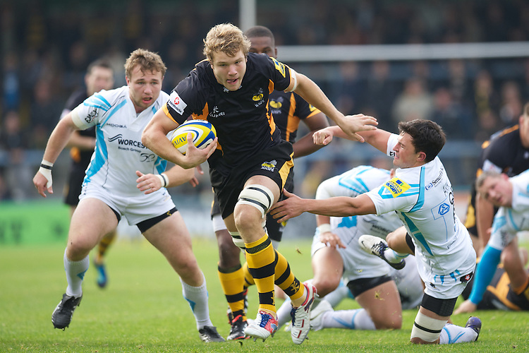 Joe Launchbury of London Wasps drives upfield past Jonny Arr of Worcester Warriors during the Aviva Premiership match between London Wasps and Worcester Warriors at Adams Park on Sunday 7th October 2012 (Photo by Rob Munro)